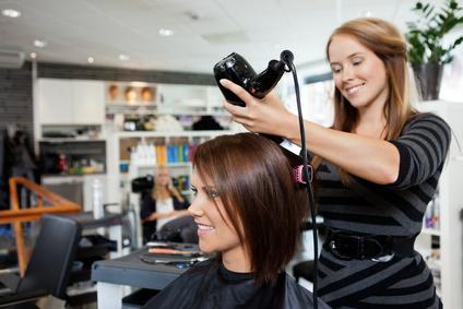 Stylist Appling keratin hair straightening treatment